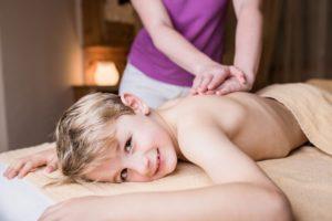 kid having ayurvedic abhyanga therapy